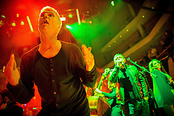 "© Licensed to London News Pictures . 05/02/2016 . Manchester , UK . BEZ . "" Hacienda Classical "" debut at the Bridgewater Hall . The 70 piece Manchester Camerata and performers including New Order's Peter Hook , Shaun Ryder , Rowetta Idah , Bez and Hacienda DJs Graeme Park and Mike Pickering mixing live compositions . Photo credit : Joel Goodman/LNP"