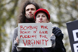 © Licensed to London News Pictures. 28/11/2015. London, UK. Members of the public protest against the bombing of Syria and Prime Minister's proposal to extend the UK air strikes against ISIS from Iraq into Syria, outside Downing Street in London on Saturday, 28 November 2015. Photo credit: Tolga Akmen/LNP