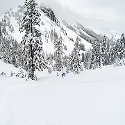 Tyler Hatcher skis in the backcountry of the Cascade Mountain Range near the boundaries of Mount Baker Ski Area.