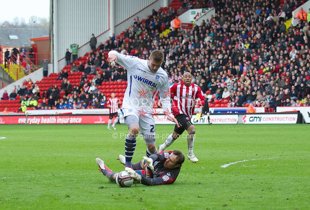 SHEFFIELD, ENGLAND - Saturday, March 17, 2012: Tranmere Rovers' Ryan Brunt and Sheffield United's goalkeeper Steve Simonsen during the Football League One match at Bramall Lane. (Pic by David Rawcliffe/Propaganda)