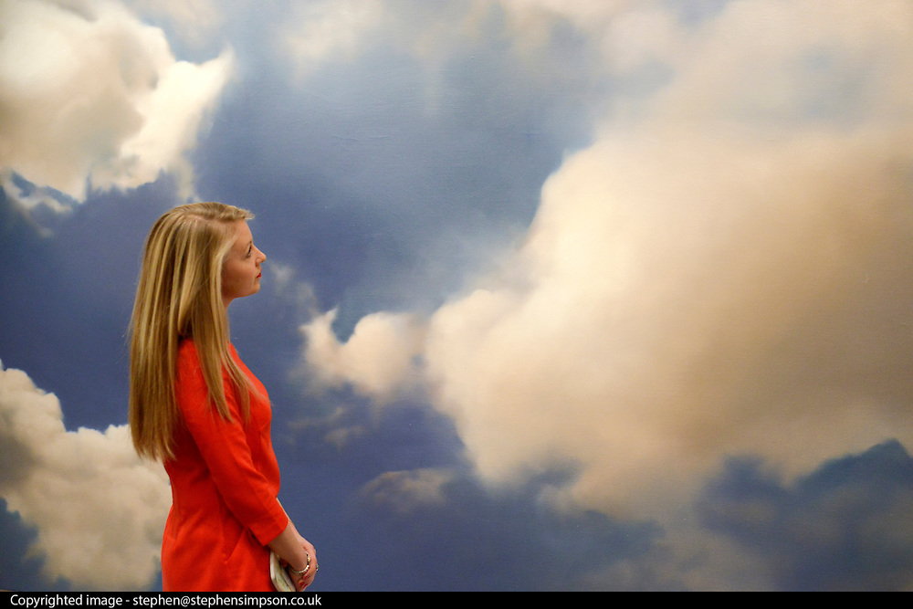 """© Licensed to London News Pictures. 31/01/2013. London, UK An employee stands in front of Gerhard Richter's oil on canvas """"Wolke (Cloud)"""" dated 1976 and numbered 413 on the reverse.  which is estimated to raise 7-9million GBP. Preview of highlights from Sotheby's forthcoming February sales of Impressionist & Modern Art and Contemporary Art in London, including works by Picasso, Bacon, Monet, Richter and Miró. Photo credit : Stephen Simpson/LNP"""