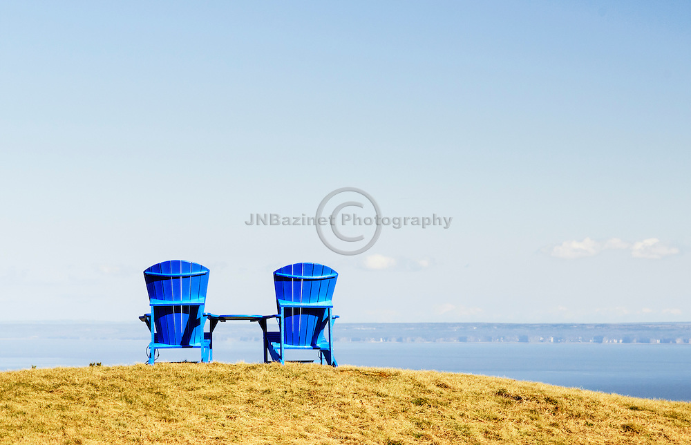 Two Adirondack chairs atop the Bay of Fundy trail, NB Canada
