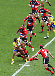 Jonny Wilkinson of Toulon tackles Wesley Fofana of Clermont during the French Top 14 Semi Final match between ASM Clermont Auvergne and RC Toulon at the Stade de Toulouse on June 3, 2012 in Toulouse, France.
