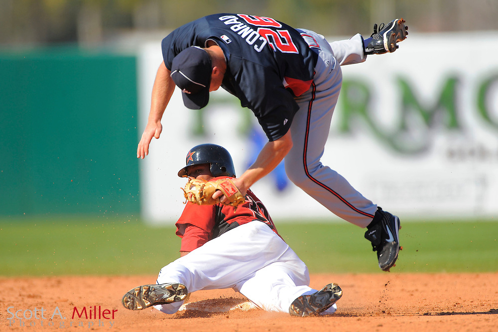 March 6, 2010; Kissimmee, FL, USA; Atlanta Braves second baseman Brooks Conrad (26) tags out Houston Astros center fielder Yordany Ramirez (30) at second base during their game at Osceola County Stadium. ©2010 Scott A. Miller