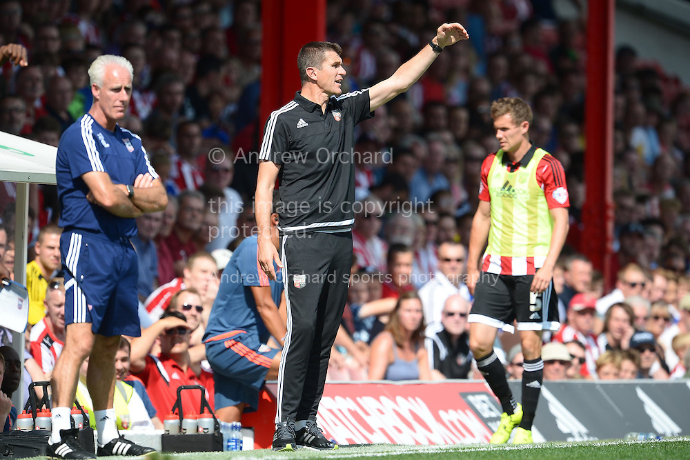 Marinus Dijkhuizen, the Brentford (c)  head coach giving directions to his players from the touchline.Skybet football league Championship match, Brentford v Ipswich Town at Griffin Park in London on Saturday 8th August 2015.<br /> pic by John Patrick Fletcher, Andrew Orchard sports photography.