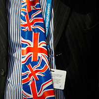 Clad in a union jack necktie, a delegate waits in line outside the auditorium for Prime Minister David Cameron's leader's address on the fourth, and final, day of the Conservatives Party Conference at the ICC, Birmingham, England on October 6, 2010.  This is the first conference since the government coalition with the Liberal Democrats.