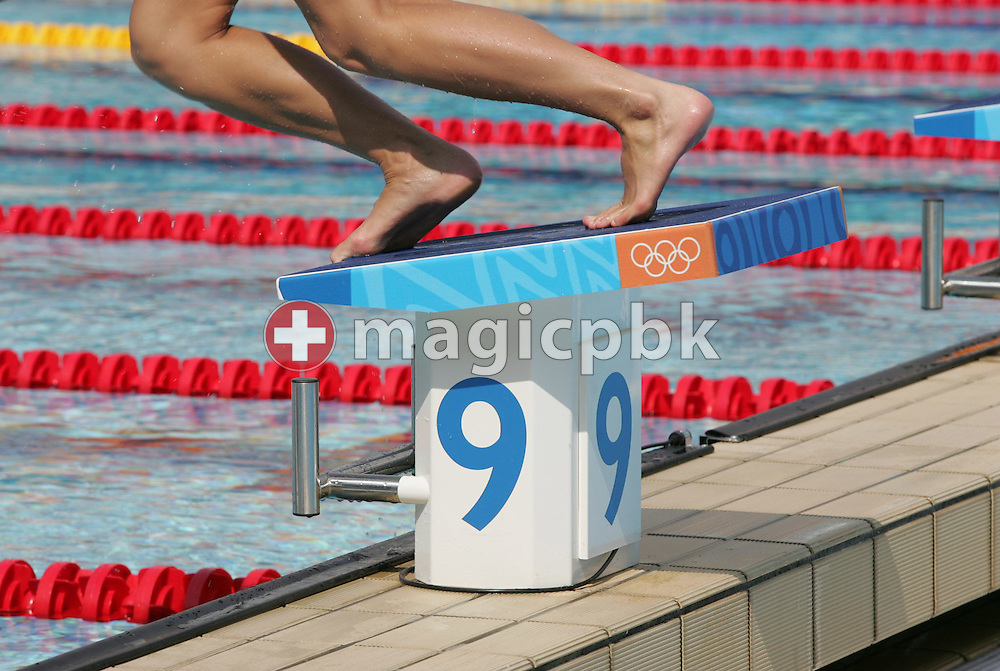 An unidentified swimmer dives into the main pool at the Olympic Aquatic Center for a practice session, Tuesday, 10 August, 2004. The games will start on August 13 with the opening ceremony in the Athens Olympic Stadium.  (Photo by Patrick B. Kraemer / MAGICPBK)