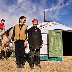 Mongolian family in a yurt. Mongolian steppe.