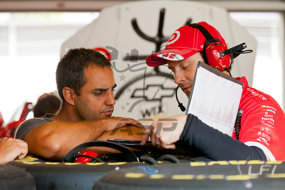 INDIANPOLIS, IN - JUL 28, 2012:  Juan Pablo Montoya (42) and prepare their car during a practice session for the Curtiss Shaver 400 presented by Crown Royal at the Indianapolis Motor Speedway in Indianapolis, IN.