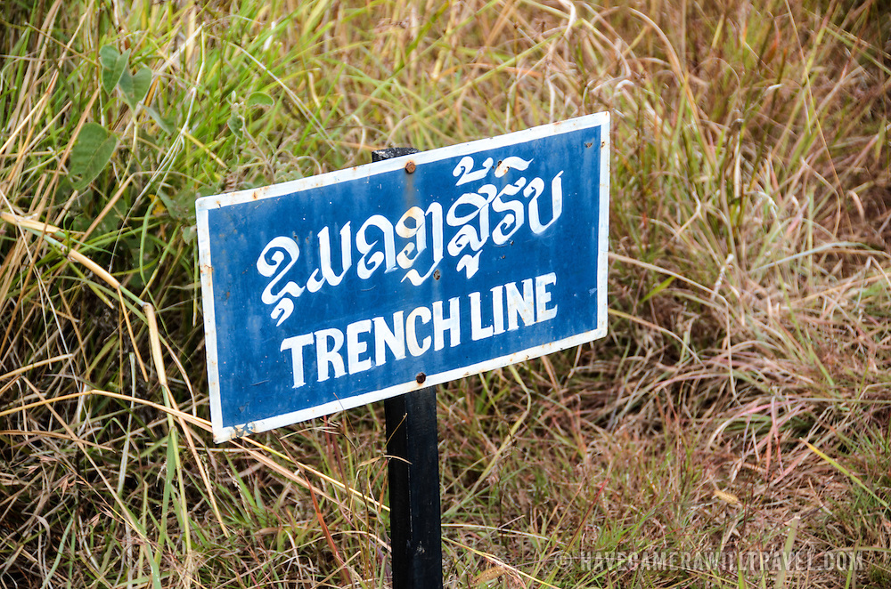 A sign marking a trench line from bomb craters at Site 1 in the Plain of Jars, Laos. The US bombing campaign from 1964 through 1973 left this region pockmarked with bomb craters.