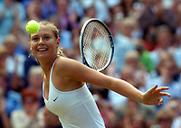 WIMBLEDON CHAMPIONSHIPS 03/07/04 DAY 12<br />MARIA SHARAPOVA (RUS) HITS THE WINNING BALL INTO THE CROWD AS SHE WINS  LADIES FINAL<br />Photo Roger Parker Fotosports International