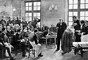 Jean Martin Charcot (1825-1893) giving a clinical lecture at the Salpetriere. Engraving after painting by Andre Brouillet. Dr Babinski hold the hysterical patient, while Mme Bottard, the chief nurse, looks on. From 'Scientific American', New York, 1887.