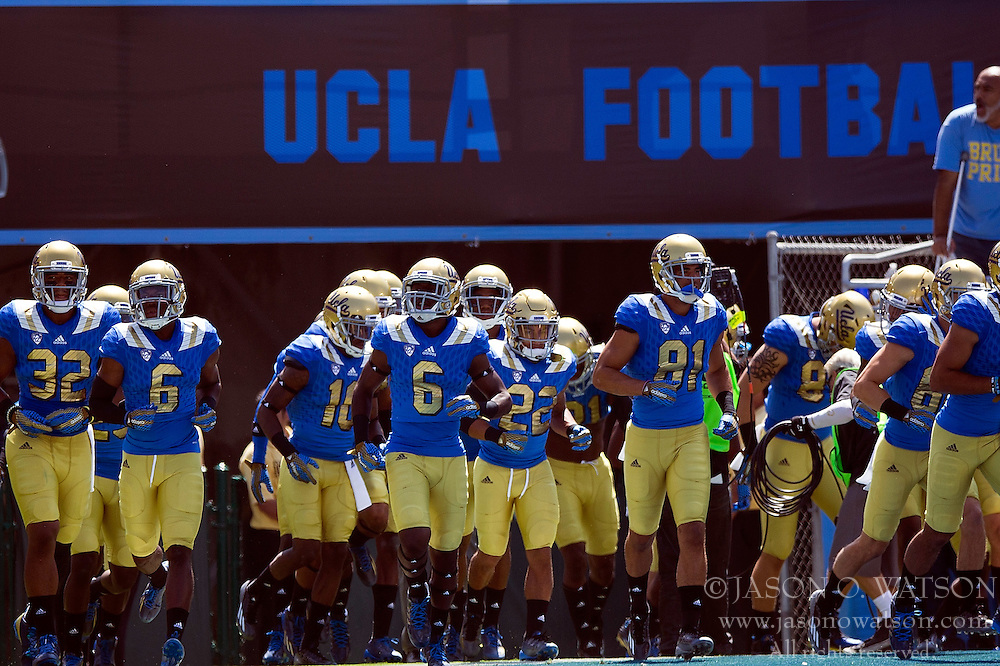 PASADENA, CA - SEPTEMBER 05:  The UCLA Bruins football team enters the field before the game against the Virginia Cavaliers at the Rose Bowl on September 5, 2015 in Pasadena, California.  The UCLA Bruins defeated the Virginia Cavaliers 34-16. (Photo by Jason O. Watson/Getty Images) *** Local Caption ***