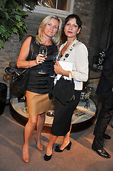 Left to right, PENNY BIZIOU and ROSANNE BENETT at the unveiling of 'The Diamond Queen' a collaboration between Asprey and artist Chris Levine in aid of The Woodland Trust, held at Asprey, 167 New Bond Street, London on 28th May 2012.