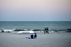After the Labor Day weekend only a few beach-goers are left at the Shore as the evening falls. (Bas Slabbers/for NewsWorks)