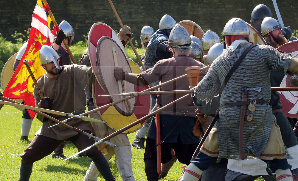 © Licensed to London News Pictures. 20/04/2019. Glastonbury, UK. Participants playing Saxon and Viking Warriors take the field of battle at Glastonbury Abbey Medieval Fayre on Easter bank holiday weekend.  Photo credit: Jason Bryant/LNP