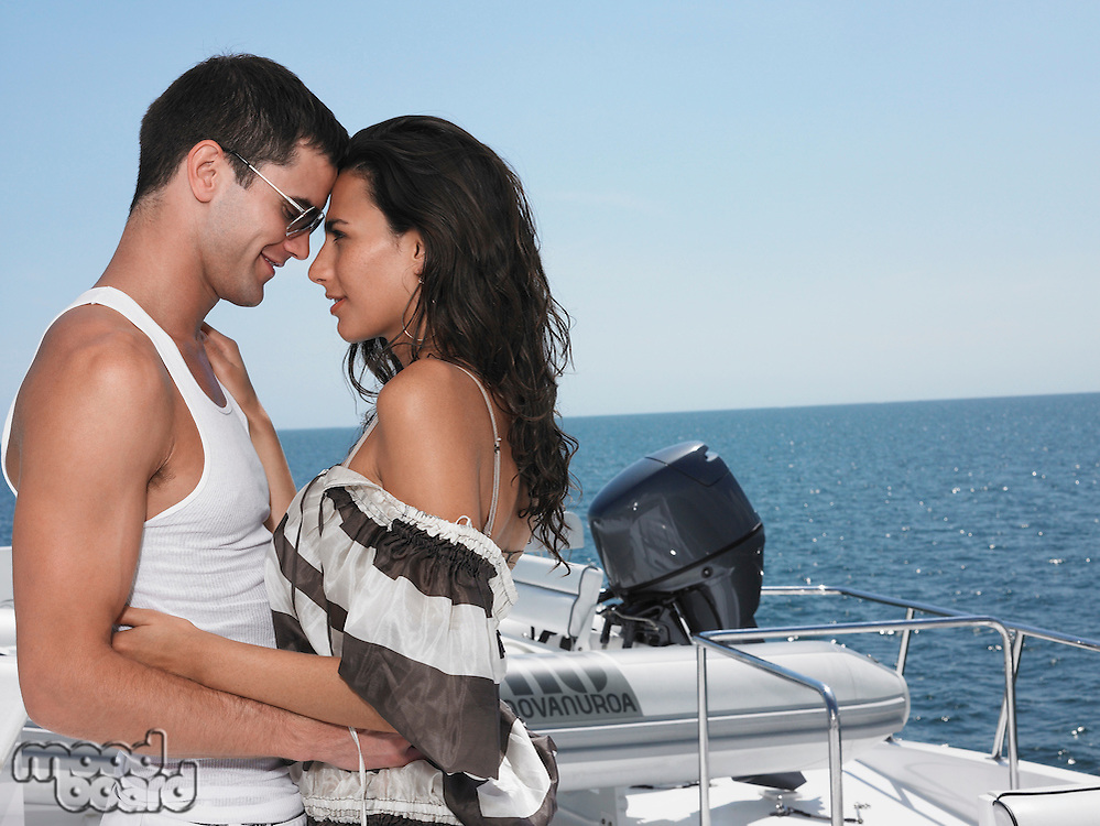 Young couple embracing on yacht profile