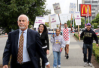 Tacoma School District Superintendent Arthur Jarvis, foreground left, is pursued by striking teachers Jami Geppert, Kimberly Tarver, Johnny Joyce and Brent Gaspaire, from left, as he leaves the City Country Building directly following Superior Court Judge Bryan Chushcoff's decision, in Tacoma, Wash., Wednesday morning, September 14, 2011.  Chushcoff said he will issue a temporary restraining order Wednesday afternoon that requires Tacoma's striking teachers to return to work until a full hearing can be held on the legality of their walkout or until they reach a contract agreement with the school district, whichever comes first. (Janet Jensen/Staff photographer)