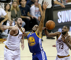 The Cleveland Cavaliers' Kevin Love, left, and Tristan Thompson (13) tangle with the Golden State Warriors' for a first-quarter rebound during Game 4 of the NBA Finals at Quicken Loans Arena in Cleveland on Friday, June 9, 2017. (Photo by Phil Masturzo/Akron Beacon Journal/TNS) *** Please Use Credit from Credit Field ***