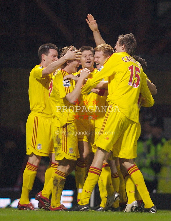 London, England - Tuesday, January 30, 2007: Liverpool players celebrate with opening goal scorer Dirk Kuyt against West Ham United during the Premiership match at Upton Park. (Pic by David Rawcliffe/Propaganda)