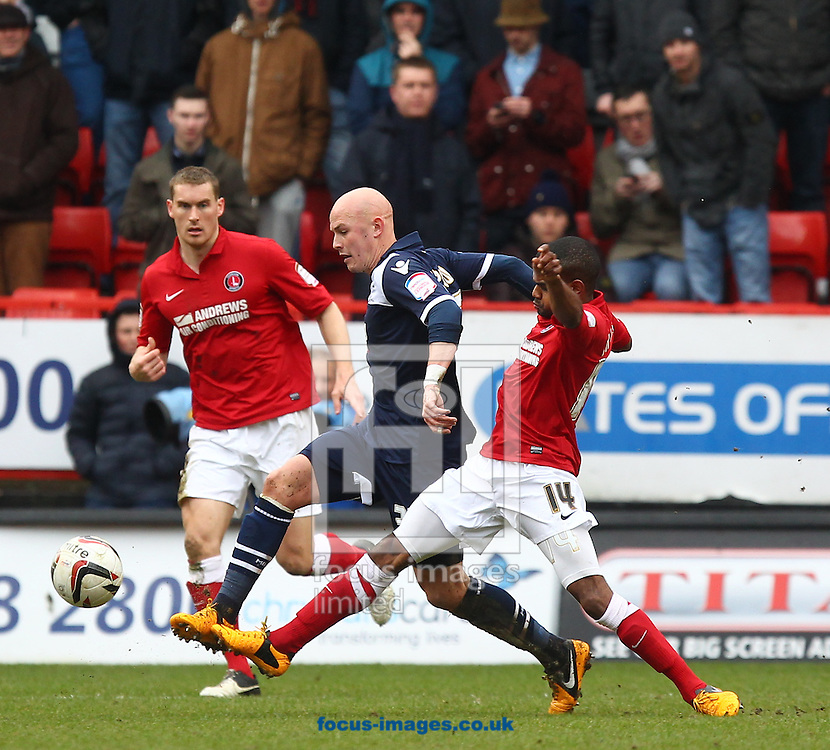Picture by John  Rainford/Focus Images Ltd +44 7506 538356.16/03/2013.Bradley Pritchard of Charlton Athletic gets in a challenge on Richard Chaplow of Millwall during the npower Championship match at The Valley, London.