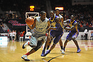"Mississippi's LaDarius White (10) vs. LSU's Shavon Coleman (5) at the C.M. ""Tad"" Smith Coliseum in Oxford, Miss. on Wednesday, January 15, 2013. Mississippi won 88-74 in overtime."