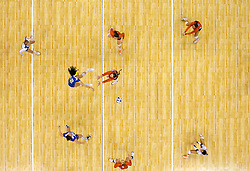 15 DEC 2011:  Mariana Aquino (12) of UCLA spikes the ball past the Illinois defense during the Division I Women's Volleyball Championship held at the Alamodome in San Antonio, TX. UCLA defeated Illinois 3-1.