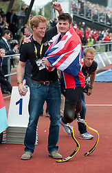 Image ©Licensed to i-Images Picture Agency. 11/09/2014. London, United Kingdom. Prince Harry and Captain Henson joke around and pose for the camera during the Invictus games. Picture by i-Images.