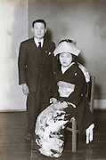 formal wedding photo with man in western style clothing Japan 1950s