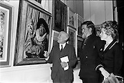 "06/05/1963<br /> 05/06/1963<br /> 06 May 1963<br /> Opening of the RHA exhibition at the National College of Art, Dublin. It was the 134th exhibition of the Academy. Image shows comedian Jimmy O'Dea viewing his likeness in the painting ""Homage to Jimmy and Frans"", the artist Sean Keating is in the centre."