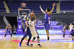 September 17, 2018 - Quezon City, NCR, Philippines - Marcio Lassiter (13, Blue) and Japeth Aguilar (25, Blue) of the Philippines tries to trap ball handler Mohamed Hassan A Mohamed (White) of Qatar. (Credit Image: © Dennis Jerome S. Acosta/Pacific Press via ZUMA Wire)