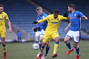 Steven Humphreys and Bradden Inman challenge for the ball during the EFL Sky Bet League 1 match between Rochdale and AFC Wimbledon at Spotland, Rochdale, England on 17 March 2018. Picture by Daniel Youngs.