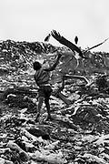 February 1995, Kenya, Nairobi, Mukuru dumpsite, dump, child, bird © ISABELLA BALENA www.isabellabalena.com