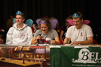 Spokesperson Nicole Turpin with team mates Patrick Duggan and Ayden Duncan of the Naturally Heavenly Spellers LHS National Honor Society team competes during the 19th annual Lakes Region Scholarship Foundation's Spelling Bee at LHS on Thursday evening.    (Karen Bobotas/for the Laconia Daily Sun)