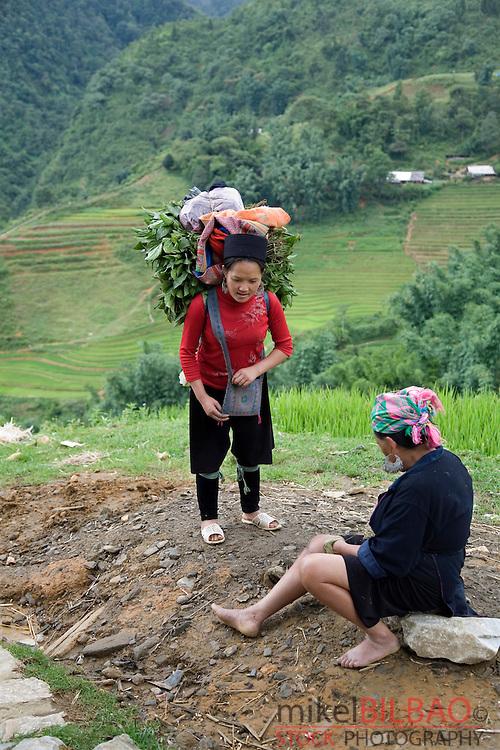black hmong ethnic women in Cat Cat village.<br /> Sapa, Lao Cai province, Vietnam.