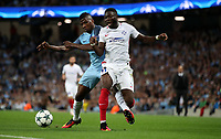 Football - 2016 / 2017 Champions League - Qualifying Play-Off, Second Leg: Manchester City [5] vs. Steaua Bucharest [0]<br /> <br /> Kelechi Iheanacho of Manchester City and Muniru Sulley of Steaua Bucharest during the match, at the Ethihad Stadium.<br /> <br /> COLORSPORT/LYNNE CAMERON