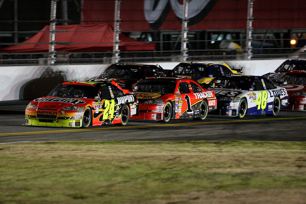 Feb. 14, 2010; Daytona Beach, FL, USA; NASCAR Sprint Cup Series driver Jeff Gordon (24), Jamie McMurray (1) and Jimmie Johnson (48) battle for position on the backstretch during the Daytona 500 at Daytona International Speedway. Mandatory Credit: Douglas Jones-US PRESSWIRE