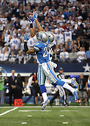 Detroit Lions cornerback Darius Slay (23) leaps and breaks up a first quarter deep pass intended for Dallas Cowboys wide receiver Terrance Williams (83) during the NFL week 18 NFC Wild Card postseason football game against the Detroit Lions on Sunday, Jan. 4, 2015 in Arlington, Texas. The Cowboys won the game 24-20. ©Paul Anthony Spinelli
