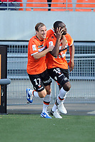 FOOTBALL - FRENCH CHAMPIONSHIP 2012/2013 - L1 - FC LORIENT v AC AJACCIO  - 28/10/2012 - PHOTO PASCAL ALLEE / DPPI - JOY GILLES SUNO (FCL) AFTER SCORING A GOAL EQUALIZER 4 EVERYWHERE. HE IS GONGRATULATED BY MAXIME BACA