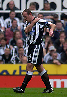 Photo. Glyn Thomas.<br /> Newcastle United v Wolverhampton Wanderers. <br /> FA Barclaycard Premiership. 09/05/2004.<br /> Newcastle's Alan Shearer tests his shoulder after receiving treatment for a shoulder problem.