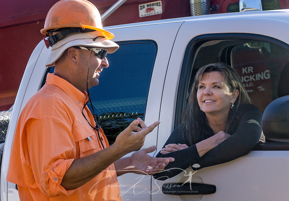 Keith Radford, owner of KR Trucking, talks with Jackie Bell, general manager of TriState Truck Center, Sept. 20, 2016, in Huntingdon, Tenn. Radford has bought 15 Mack Granite dump trucks and a Mack Titan from TriState, using Mack Financial Services. He is currently working with TriState to order seven additional Mack Granites. (Photo by Carmen K. Sisson/Cloudybright)