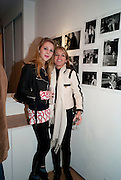 ELIZA HENDERSON; LUCINDA GARLAND;, The Way We Wore.- Photographs of parties in the 70's by Nick Ashley. Sladmore Contemporary. Bruton Place. London. 13 January 2010.<br /> ELIZA HENDERSON; LUCINDA GARLAND;, The Way We Wore.- Photographs of parties in the 70's by Nick Ashley. Sladmore Contemporary. Bruton Place. London. 13 January 2010. *** Local Caption *** -DO NOT ARCHIVE-© Copyright Photograph by Dafydd Jones. 248 Clapham Rd. London SW9 0PZ. Tel 0207 820 0771. www.dafjones.com.