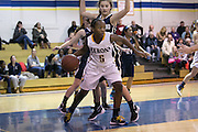 Makalah Sizer of Brighton looks for a pass during a game against Pittsford Sutherland at Brighton High School on Thursday, January 21, 2016.