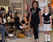 Faith Ehring of Centerville (right,) and LaRashia Simone Edwards of Trotwood during a fashion show at the Elder Beerman store in the Dayton Mall, Saturday, August 14. 2010..