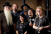 A group portrait of the Vince Martell Band after their performance at The Bus Stop Music Cafe in Pitman, NJ From the left: Vic Martinson/owner of the cafe, Pete Bremy'bass, Peg Pearl/keyboards & vocals, Juma Sultan/percussion, Vince Martell/guitar, and Russ T. Blades/drums.