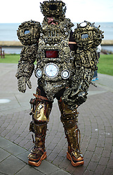© Licensed to London News Pictures. <br /> 01/11/2014. <br /> <br /> Whitby, Yorkshire, United Kingdom<br /> <br /> A man is dressed up in a full Steampunk body suit during the Whitby Goth Weekend. <br /> <br /> The event this weekend brings together thousands of extravagantly dressed followers of Victoriana, Steampunk, Cybergoth and Romanticism who all visit the town to take part in celebrating Gothic culture. This weekend marks the 20th anniversary since the event was started by local woman Jo Hampshire.<br /> <br /> Photo credit : Ian Forsyth/LNP