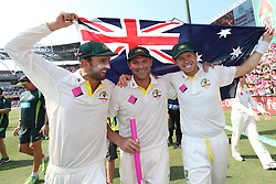 © Licensed to London News Pictures. 05/01/2014. Nathan Lyon, Ryan Harris and Peter Siddle carry the Australian flag during celebration lap during day 3 of the 5th Ashes Test Match between Australia Vs England at the SCG on 5 January, 2013 in Melbourne, Australia. Photo credit : Asanka Brendon Ratnayake/LNP