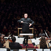 November 25, 2012 - New York, NY : Music director Joshua Gersen leads the New York Youth Symphony in  the world premiere of Gabriel Zucker's 'Universal at Midnight' (2012) in Carnegie Hall's Isaac Stern Auditorium on Sunday afternoon. CREDIT: Karsten Moran for The New York Times