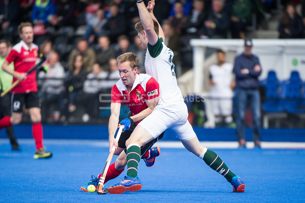 Holcombe's Barry Middleton tries to go round Brendan Creed of Surbiton. Holcombe v Surbiton - Semi-Final - Men's Hockey League Finals, Lee Valley Hockey & Tennis Centre, London, UK on 22 April 2017. Photo: Simon Parker