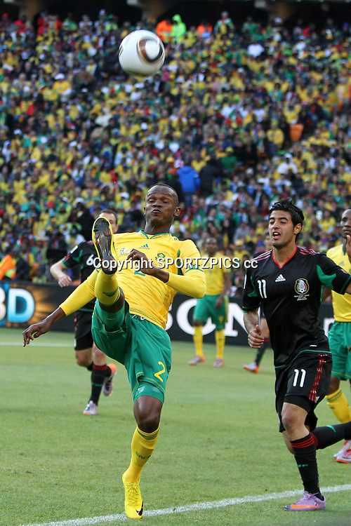 Siboniso GAXA clears from Carlos VELA during the opening match ( match 1) of the FFA World Cup 2010 South Africa held at Soccer City in SOWETO, Johannesburg, South Africa on the 11th June 2010<br /> <br /> Photo by Ron Gaunt/SPORTZPICS